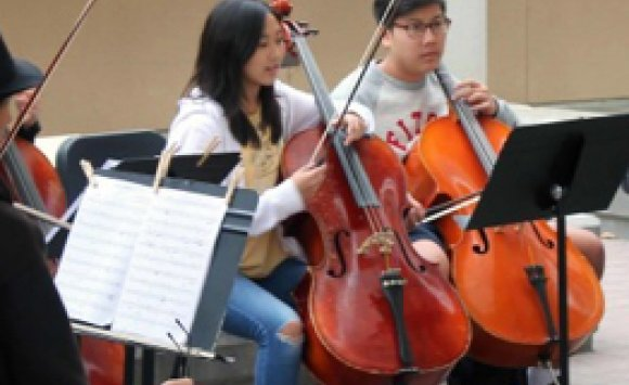 students with instruments in a classroom