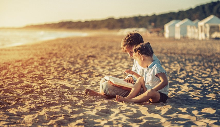 Children Reading on the Beach