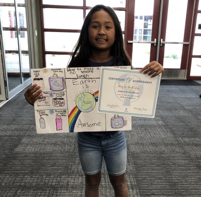 Averie McKinley with her winning IUSD Earth Month poster