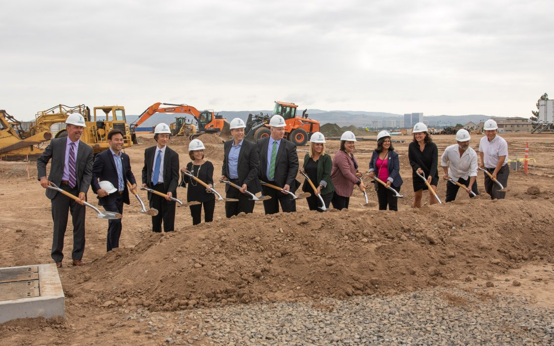Superintendent Terry Walker, IUSD Board and Irvine City Officials posing with shovels