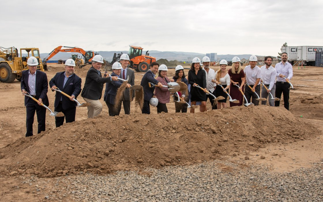 City Officials and Developer Employees Posing with Dirt