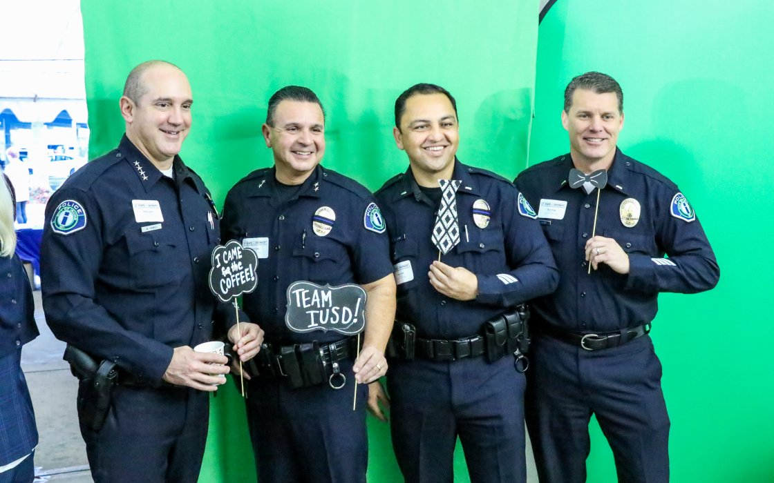 officers in front of green screen