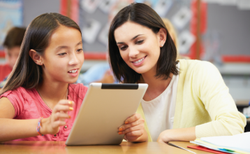 Student and teacher looking at iPad