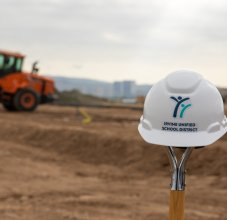 iusd construction hat in front of site