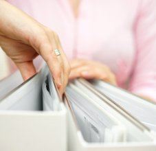 person looking through documents