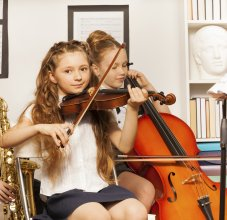 students with string instruments