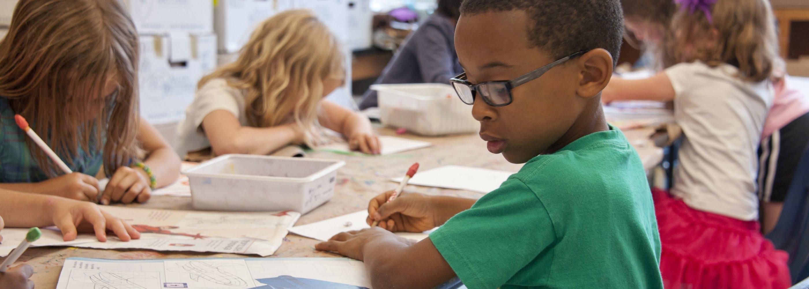 little boy learning in a classroom