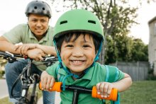 Boy with father helmet safety