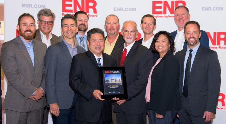 IUSD design and construction team receiving ENR award
