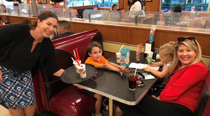 Principal Beal Serving Milkshakes at Ruby's Diner