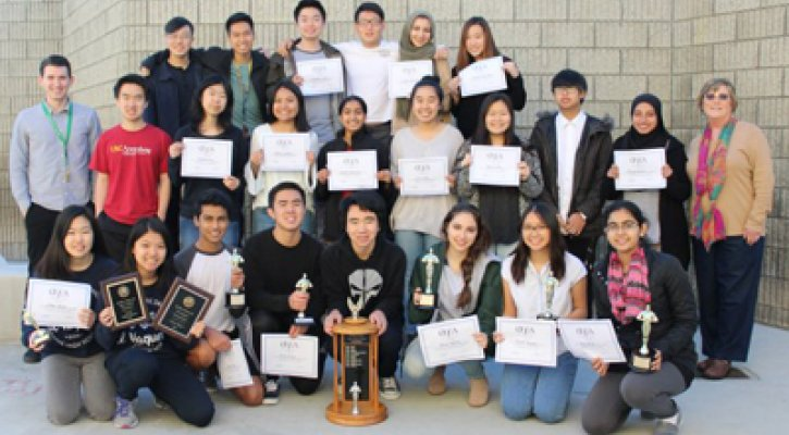 Irvine High School Publication team posing with trophy