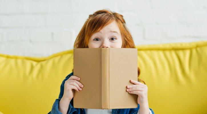 IUSD Book Lover Day. Girl Reading Book