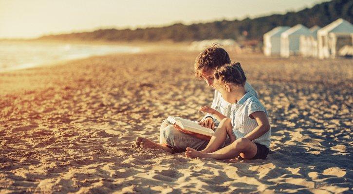 Children Reading on the Beach